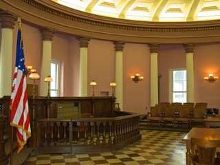 a federal immigration courtroom with checkered floor