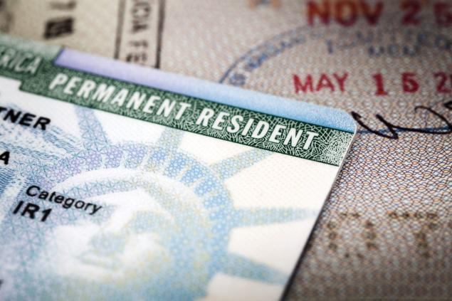 A closeup picture of a Permanent Residence Card, also known as a green card given.