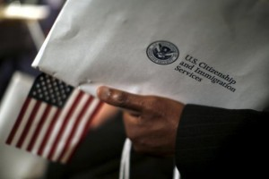 a hand holds an application for USCIS immigration to the US